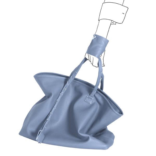Catherine Loiret, Des sacs en cuir, raffinés, dissimulent des trésors de détails, de flexibilité et de jeux simpli-cube blue